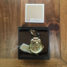 Michael Kors tortoise shell chain link watch MK tortoise shell chain linked watch. Removable link. The hands on the clock glow in the dark. Has been worn, some visible scratches on the outside of the gold face (I tried to show them in the pictures- can take closer ones if anyone needs) comes with case and MK manual. Michael Kors Jewelry