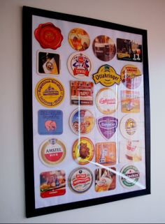 Beer coasters from all over Europe framed in the wall.