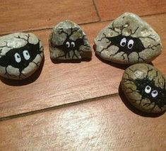 It's dark in here!   Painted rocks w/hidden monsters.