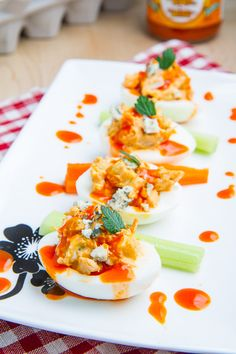 Closet Cooking: Buffalo Chicken Deviled Eggs 6 eggs, boiled, cooled, peeled, and cut in half 1 tablespoon mayonnaise or Greek yogurt 2 tablespoons buffalo wing hot sauce 1/4 cup chicken, finely shredded or diced 2 tablespoons carrot, finely diced 2 tablespoons celery, finely diced 1 tablespoon onion, finely diced 2 tablespoons blue cheese, finely crumbled