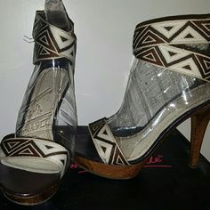 Tribal print heels Very comfortable worn a couple times. Stitched tribal design on shoe straps. Zipper on back for easy on and off Anne Michelle Shoes Heels