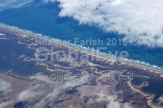 Coorong from the air. The Coorong is a lagoon ecosystem at the mouth of the Murray River in South Australia. This national park is now threatened due to lowering water levels.Stock Photo By Heather   Farish