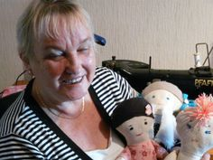 Maria with her handmade baby dolls!