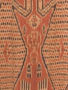detail of pua kumbu showing male figures
