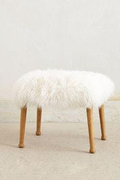 anthropologie stool - easy, cheap reinterpretation: throw a small flokati over vanity stool (easier to wash, too)