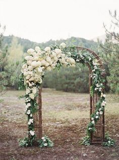 Rustic Wedding Arch with White Flowers and Branches. What a beautiful wedding arch decoration idea! Love it!