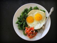 Garlicky Kale with Fried Eggs & Salsa (makes 2 servings; average cost per serving: $1.25)
