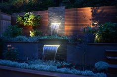 I really love how the lighting makes this water features noticeable at  night.  I love to spend warm summer night out on my patio and I would love something like this in my yard.  I think it would look great in a modern home and yard as well.