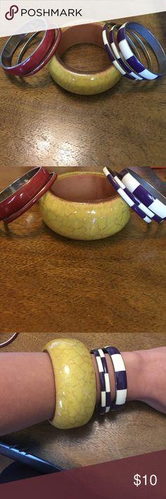 Bangle bracelet bundle! A total of 6 bracelets. 3 striped purple, 2 red and one large yellow. Jewelry Bracelets