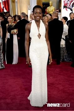 Lupita Nyong'o arrives at the Oscars wearing a dress made of pearls at the Dolby Theatre in Los Angeles. Los Angeles sheriff's detectives are investigating the theft of the $150,000 custom Calvin Klein dress worn by Nyong'o at the 2015 Academy Awards. The dress was reported stolen from Nyong'o's West Hollywood hotel room late on Wednesday Feb. 25, 2015. (Photo by Chris Pizzello/Invision/AP, File)