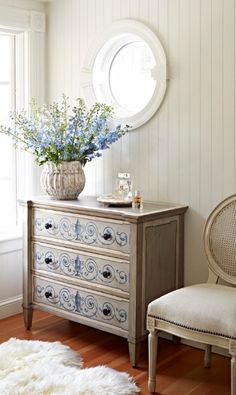 Delicate cornflower blue urns surrounded by vining scrolls decorate the face of the three drawers of the Handpainted Gesso Chest.  | Frontgate Interiors