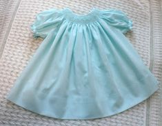This is the seafoam Imperial Batiste bishop that I smocked in Arizona. I made the dress as a ready-to-smock so that once the smocking was d. Smocking Plates, Smocking Patterns, Snowflake Dress, Mademoiselle, Heirloom Sewing, Smock Dress, Baby Sewing, Clothing Patterns, Doll Clothes