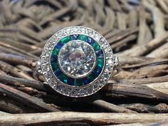 Beautiful Target ring! Old cut diamond with emeralds and sapphire border, in platinum! Available now at cobwebs.ie or cobwebs@eircom.net