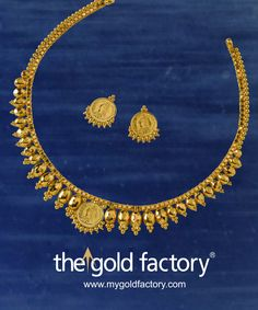 A graded line of gold capsules, each with a trikon ball edging, is broken at the centre by Queen Victoria in a coin. And she appears in the eartops as well. A whimsical jewel in 22K hallmarked gold from the one and only Gold Factory.  Necklace weight 5 gm & price Rs.16,000/- Earring weight 1.5 gm & price Rs.4,900/-