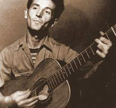 Woody Guthrie - Talkin' Dust Bowl Blues - http://www.youtube.com/watch?v=OQBcM-fCZlw