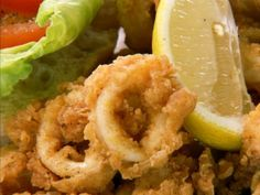 Fried Calamari by Chuck Hughes. Cooking Channel serves up this Fried Calamari recipe from Chuck Hughes plus many other recipes at CookingChannelTV.com