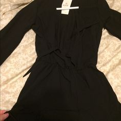 Deep V neck black romper This romper is super site! Pair with booties and you are good to go. It runs small - please keep this in mind when ordering. Brand new. It has a little tie in the front and ruffles on the bottom. Baluoke Other