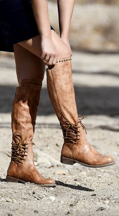 Your search for a new pair of tan flat knee high boot is officially over. Hand made leather riding boot style by BEDSTU. Stud details on the knee will make a true statement.
