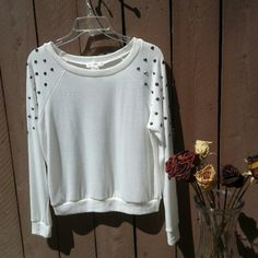 Nwot soft White long sleeve button top Soft White detail sweater top Very lightweight.  Never worn still in new mint condition  Smoke / pet free home  Any questions please feel free  (Price is firm) thanks for looking and stopping by xoxo a'gaci Tops Tees - Long Sleeve