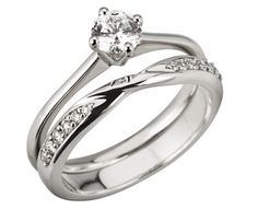 platinum and diamond compass solitaire and ribbon twist ring set