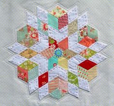 English Paper Piecing. Loving those little pieces of California Girl fabric in there.