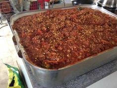 Coupez les légumes en petit morceau. Mettre la viande dans une rôtissoire...