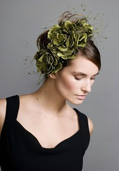 Green flowers with chopped coque feathers on crescent  Rachel Trevor-Morgan