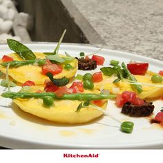 "Parmigiano Reggiano Crème Brulee"" Ravioli with Green Peas,  Morels and Asparagus"