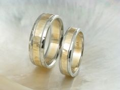 unique hammered wedding ring set -- 14k gold duo tone / two tone wedding bands. $1,760.00, via Etsy.