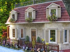 The French Countryside Stone cottage Dollhouse           This is the lovely Stone Cottage dollhouse with a working waterwheel. It is a Fre...