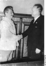 Stalin and Ribbentrop shaking hands after the signing of the German-Soviet non-aggression pact, Moscow, Russia, 23 Aug 1939