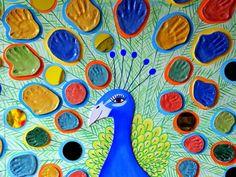 Super fun way to display children's hand prints. #peacock #artinspiration