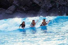 Girls bodyboarding and enjoying the Ocean Dome wave pool in Japan