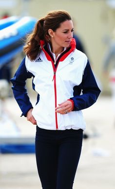 Duchess Catherine in Team GB windbreaker jacket, Zara skinny jeans, and red Adidas sneakers at the London Olympics, August 2012