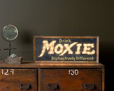 VINTAGE MOXIE SODA LIGHT UP SIGN.  In original condition, this very early light up moxie sign is definitely a shop favorite. Original copper frame