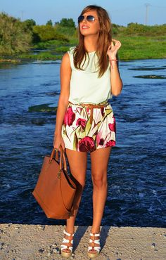 fun dressing for the summers, floral print skirt with white top, sunglasses complete the look
