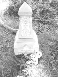 Grave site of Emma R Porter. Note halo over her gift.