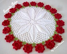crochet pinwheel effect white doily with red flowers around edges