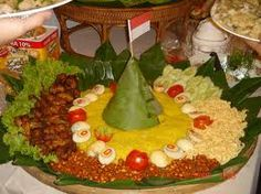 It's called rice cones typical of Indonesia. The yellow color is more tempting tastes.