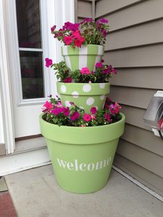 """Stacked flower pots """"welcome"""""""