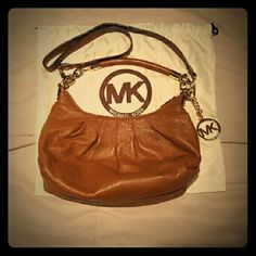 Michael Kors Brown Leather Handbag Gorgeous brown pebbled leather Michael Michael Kors shoulder bag. In amazing condition. No issues at all. Comes with dust bag shown in photos. MICHAEL Michael Kors Bags Shoulder Bags