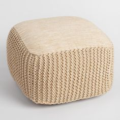 Add stylish extra seating indoors or outdoors with our natural-toned pouf featuring gorgeous woven texture and hints of metallic Lurex thread for a bit of shimmer.