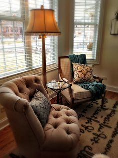 love the two different chairs, anchored by a throw rug. . . yup, I have just the corner in my new office