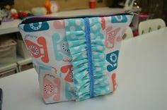 A student adds a little #ruffle to her zipper pouch