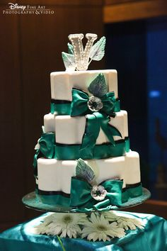 Turquoise bow three-tier Disney wedding cake - love it!