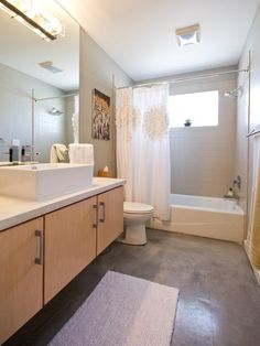 Nice and serene - maple cabinets, gray floors, white walls. Modern Bathrooms from Erica Islas : Designers' Portfolio 4468 : Home & Garden Television