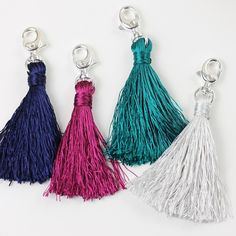 1 Skein of Embroidery Floss 1 Lobster clip = The cutest tassel keychain (or zipper pull). It was so easy to make!