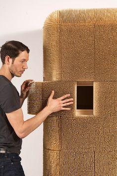 the 80,000 bamboo skewers that cover new york-based artist and designer sebastian errazuriz's 'magistral cabinet',  act as a protective armor, safely holding one's personal belongings within. the doors and openings   within the storage unit are concealed, and can be slid open to reveal its inner mechanisms.