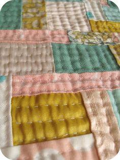 Love the hand quilting. I always worry my stitches are too big, but this makes me want to get over it and just quilt.