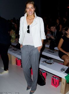 Jessica Hart wore a simple pair of grey trousers and a white jacket at Betsey Johnson  http://dailym.ai/1qKp0dg #NYFW